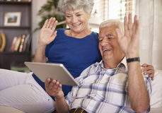 Video conversation. Elder couple having a video conversation Royalty Free Stock Photos