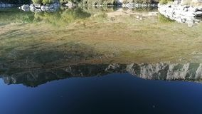 Mountain reflection in a lake a clean water. stock video footage