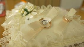Video on a cushion of lace lie rings bride and groom. Video on cushion of lace lie rings bride and groom stock video footage
