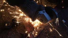 Video cutting a metal workpiece with a plasma spark cutter stock footage