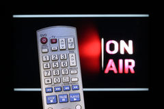 Video on Demand. Television remote control and TV with On-Air sign stock photography
