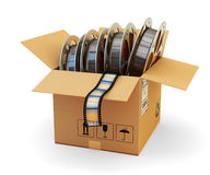 Video on demand and multimedia pack concept. Open cardboard box with film reels on white background Stock Image