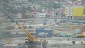 Video di Timelapse del cantiere nell'inizio dello sviluppo del programma di costruzione di alloggi nuovo Lavoratori e movimento d archivi video