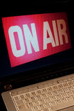Video Download. Computer displaying On-Air sign suggesting live streaming or a video download or wireless connection. Vertical aspect royalty free stock photography