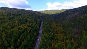 Video drone aerial view over the road in the forest on the way to Lake Baikal. Ulan-Ude stock footage