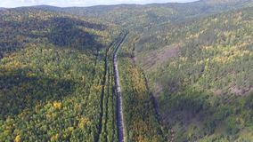 Video drone aerial view over the road in the forest on the way to Lake Baikal stock video