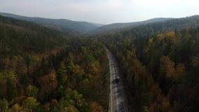 Video drone aerial view over the road in the forest on the way to Lake Baikal stock video footage