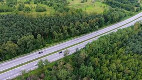 Video drone aerial view over the road in the forest on the way to north of Poland. stock video