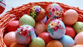 Video easter eggs. Painted easter eggs on white background in a red wicker basket stock video footage
