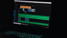 Video editing on a computer, postproduction, clip maker- 4K. Video editing on a computer. Monitor the computer and capture the work of the program for video stock footage