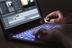 Video editing with laptop. Professional editor. Video editing with laptop. Professional editor adding special effects or color grading footage for commercial stock image