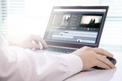 Video editing with laptop. Professional editor working. Video editing with laptop. Professional editor working in creative studio office royalty free stock photo