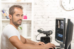Video editor. With computer and professionnal video camera royalty free stock image