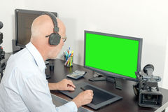 Video editor in his studio. A video editor in his studio royalty free stock images