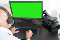 Video editor in his studio. A video editor in his studio stock photography