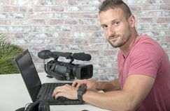 A video editor with laptop and professional video camera. A video editor with laptop computer and professional video camera stock images