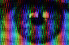 Video Eye. Detailed macro close-up of L.E.D. television screen with image of eye Stock Images