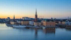Video för Tid schackningsperiod av den Stockholm Gamla Stan horisontdagen till natten i Sverige, Timelapse 4K stock video