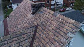 Video Feed of Drone Inspecting Damaged Slate Roof stock footage