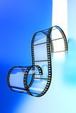 Video film strip on a blue background. Hi-res digitally generated image Royalty Free Stock Photography