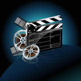 Video film tape and cinema clapper. Video film tape with cinema clapper and filmstrip on blue background Stock Photography