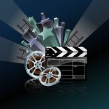 Video film tape and cinema clapper. Video film tape with cinema clapper and filmstrip on blue background Royalty Free Stock Photography