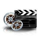Video film tape with cinema clapper and filmstrip. On blue background Royalty Free Stock Image