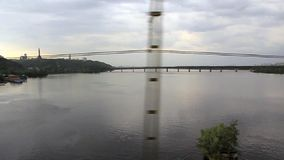 Video filming of Dnieper river from moving train on railway bridge stock video footage