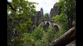 Video footage of Bastei Bridge in Saxon Switzerland, Germany. Sandstone rocks. Cloudy and windy weather stock video footage