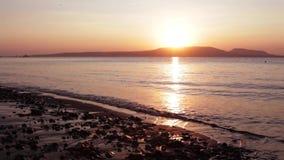 Beautiful sunrise view at shore in Bali island. Video footage of beautiful sunrise view at tropical seashore in Bali island, Indonesia stock footage