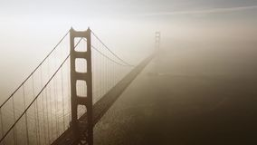 Video footage of bridge in fog with flying camera across it stock footage