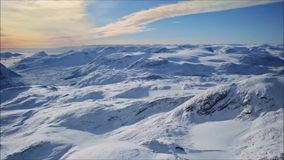 Video footage of camera flying over arctic landscape