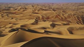 Video footage of camera flying over the dunes and sand stock video footage