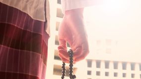 Hand counting a prayer beads in mosque stock video footage
