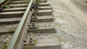 Video footage of the rails, soft focus, extreme close up, vertical panorama. Full HD video. Children`s railway in the city`s central park. Video footage of the stock footage