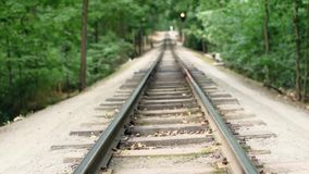 Video footage of the rails, soft focus, extreme close up, vertical panorama. Full HD video. Children`s railway in the city`s central park. Video footage of the stock video