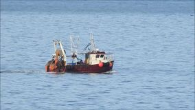 Fishing tug boat on shipping lane. Video footage of a tug boat on the kent coast of whitstable heading for the open seas for a catch oct 2017 stock video