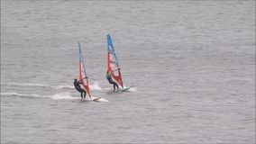 Windsurfers in training. Video footage of windsurfers windsurfing on the coast of whitstable in kent england during october 2017 stock video