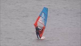 Windsurfers in training. Video footage of windsurfers windsurfing on the coast of whitstable in kent england during october 2017 stock video footage