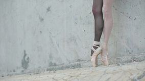 Video footage of the young graceful ballerina feet stock video