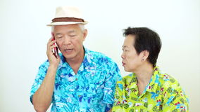 Video Frustrated Asian couple have problem on holiday trip. Aggressive phone call complain and upset stock footage
