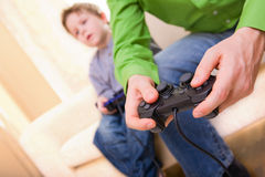 Video Game. Father and son with video game controllers Royalty Free Stock Photo