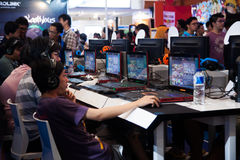 Video Game Competition on Indo Game Show 2013. Jakarta, Indonesia, 8th September 2013: Several competition participants playing video games on a video game Royalty Free Stock Images