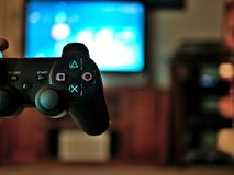 Video game console controller for gaming held in gamers hands. Video game console controller in gamers hands Stock Image
