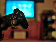 Video game console controller for gaming held in gamers hands. Video game console controller in gamers hands Stock Photos