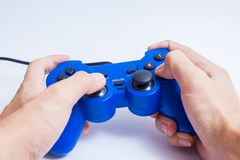Video game console controller. Hand holding Video game console controller Stock Images