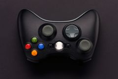 Video game controller. On black background Royalty Free Stock Images