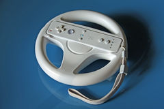 Video game controller on blue background Stock Photo