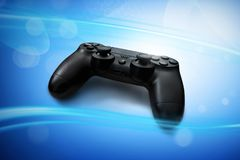 Video games controller on blue background Royalty Free Stock Photography