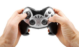 Video game controller in hand isolated on white Royalty Free Stock Photos